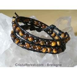 Bracelet boule 6 mm  Oeil de tigre, doublé sur cuir